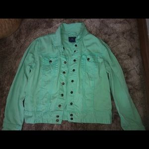 In good condition green jean jacket